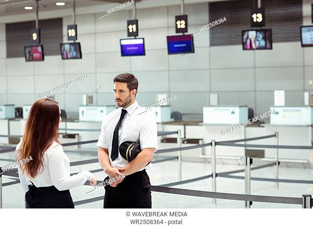 Pilot and flight attendant interacting with each other