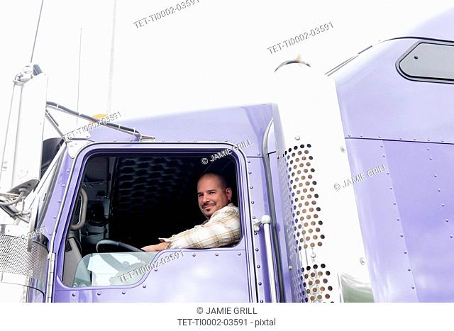 Man driving semi-truck
