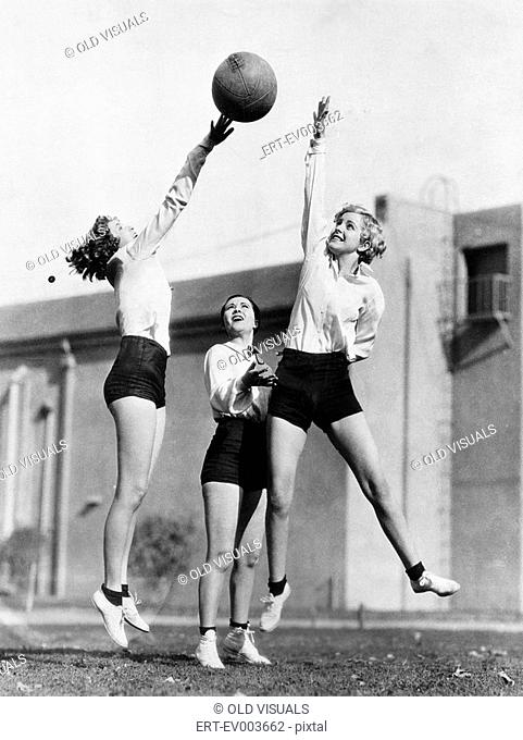 Three women with basketball in the air All persons depicted are not longer living and no estate exists Supplier warranties that there will be no model release...