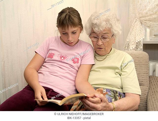 Girl reads with granny