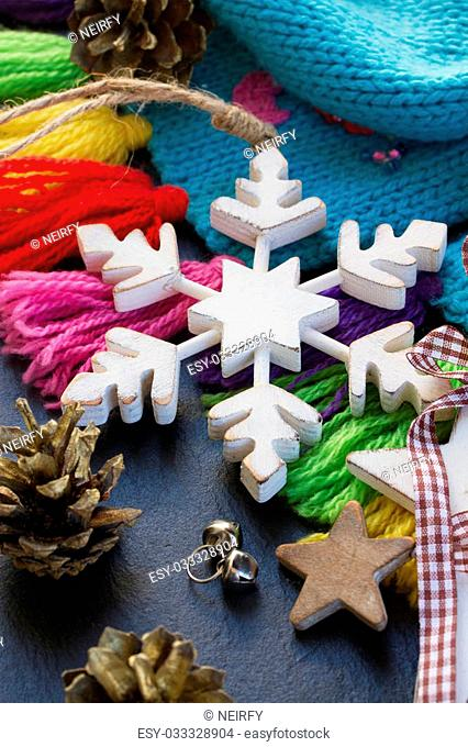 white wooden retro snowflake with christmas decorations on black background