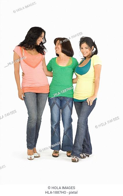 Senior woman standing with her two daughters and smiling