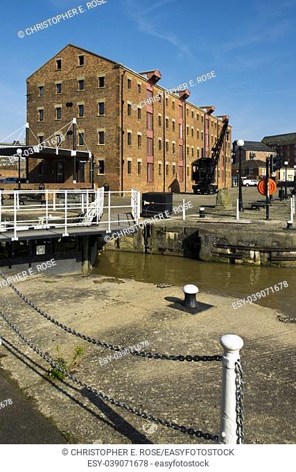Spring sunshine on the industrial heritage travel destination of Gloucester Docks, Gloucester, UK