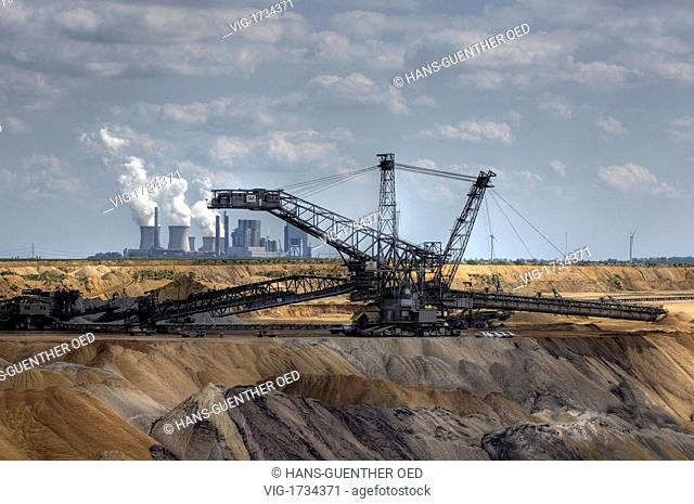a so called stacker at open-cast lignite mine Garzweiler, coal fired power plant Neurath in the background - Garzweiler, Nordrhein-Westfalen, North Rhin