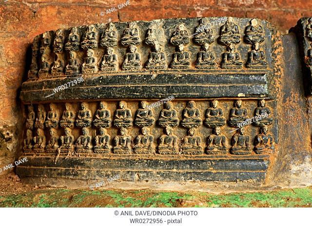 Statues of Buddha and remains of ancient Nalanda university , Bihar , India