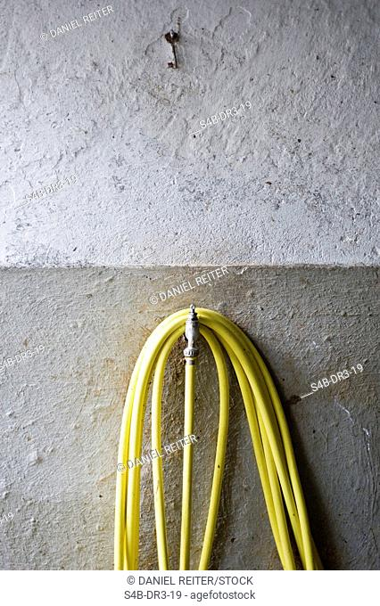 Water tube and a key at a wall