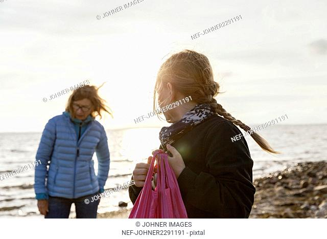 Grandmother with granddaughter on beach