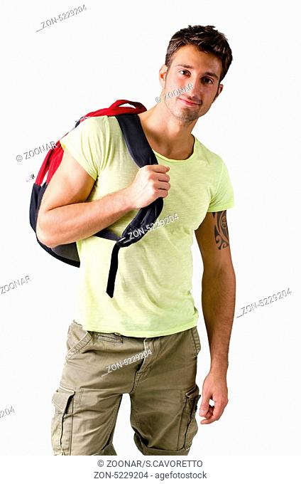 Attractive young man with backpack, isolated on white background, looking at camera