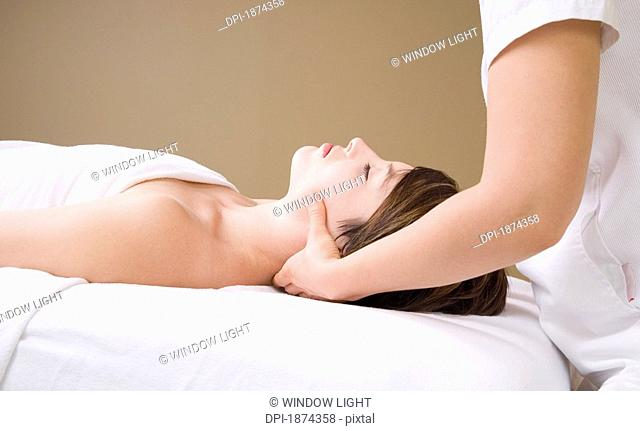 getting a neck massage from a massage therapist
