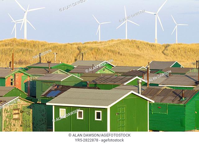 Redcar, north east England. United Kingdom. Fishermans huts at the South Gare near Redcar on the north east coast of England with Teesside Offshore Windfarm in...