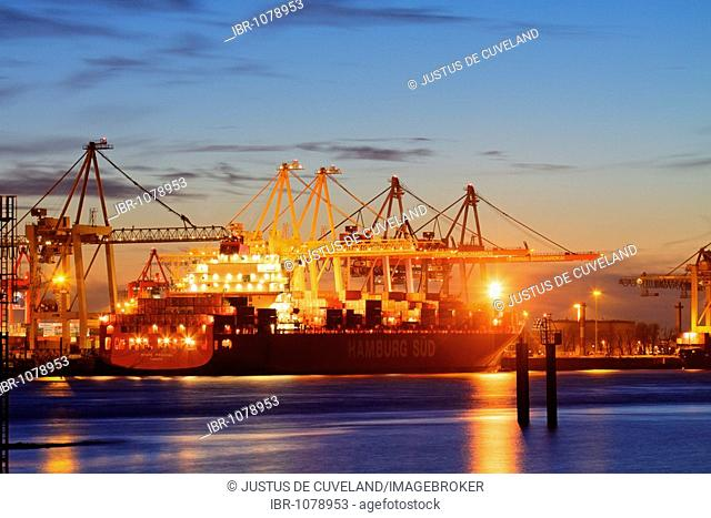 Container ship Monte Pascoal at night, being loaded with containers at the Buchardkai container terminal in Hamburg Harbour on Elbe River, Hamburg, Germany