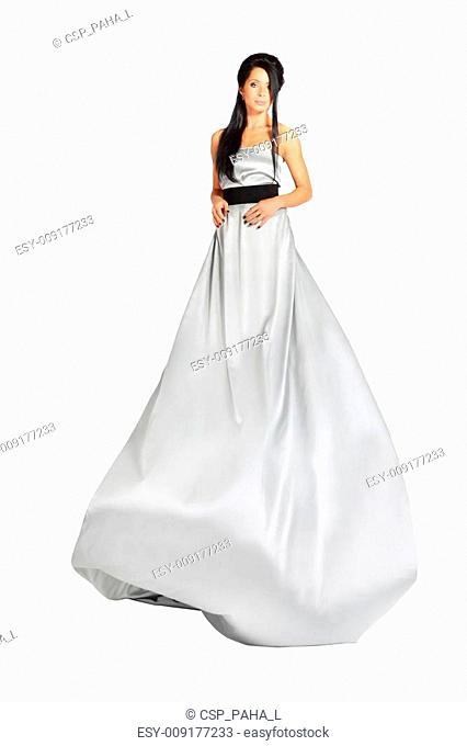 beautiful smart girl wearing long silver dress isolated on white background; skirt flutters