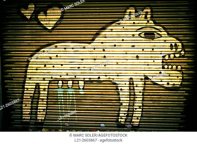 Graffiti depicting a female animal with mouth open, mural painted on an iron fence. Barcelona, Catalonia, Spain