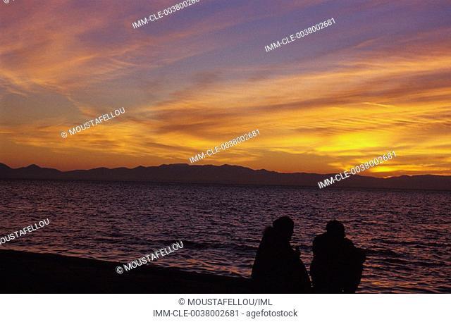 Couple on beach,sunset , Greece:Central Macedonia:Thessaloniki