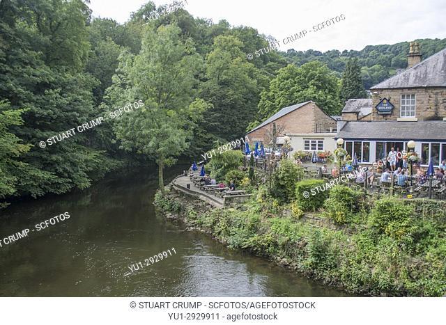 River Derwent flowing past the Midland Public house in Matlock Bath Derbyshire UK
