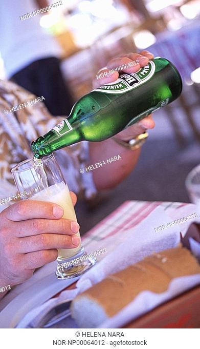 Man pouring himself a glass of beer