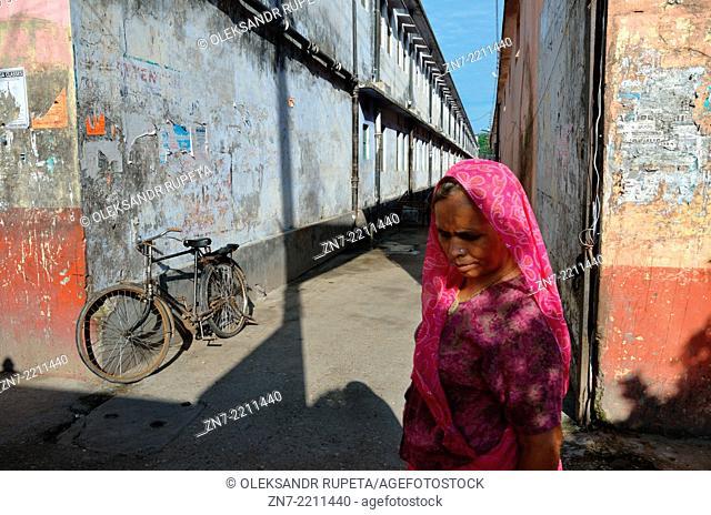 A woman walks on street in Rishikesh, India