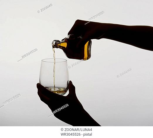 woman pouring whiskey