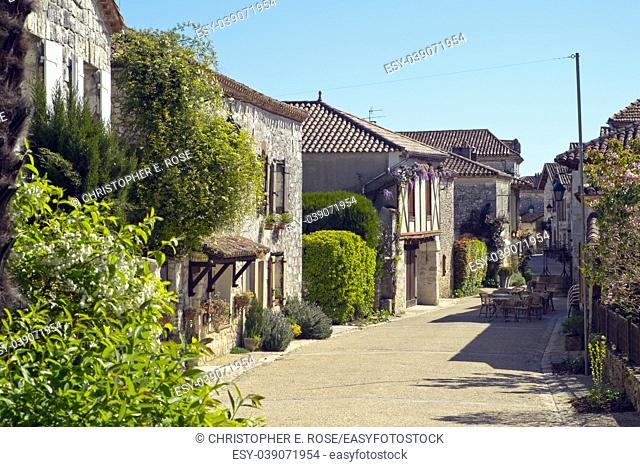"A quiet picturesque street in Pujols, Lot-et-Garonne, France. This historic village is a member of """"Les Plus Beaux Villages de France"""" association"