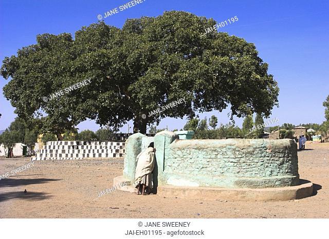 Ethiopia, Lalibela, Pilgrim opposite St Mary of Zion old Church