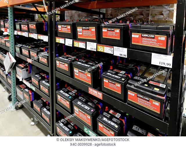 Kirkland brand car batteries on shelves at Costco Wholesale membership warehouse store. British Columbia, Canada