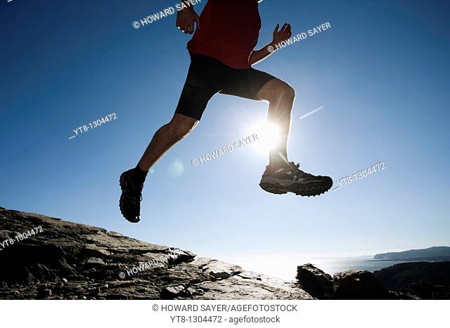 Man leaping through the air whilst running