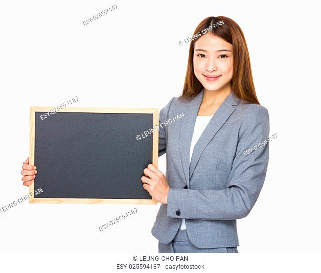 Asian business girl holding blank blackboard