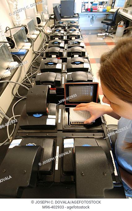 Female technician loading PCR machine