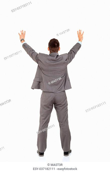 Rear view of business man hands rised with open palms. isolated over white background, full length portrait of businessman standing back