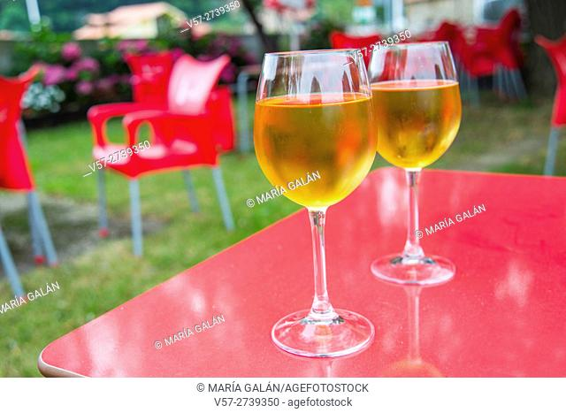 Two glasses of cider in a terrace. Cantabria, Spain