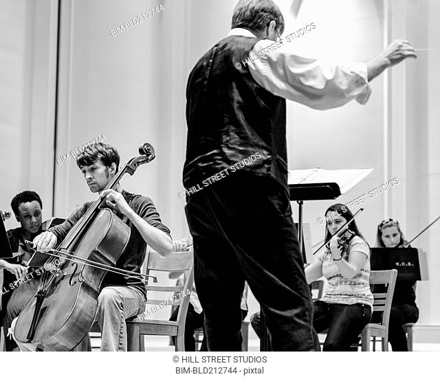 Professor conducting college orchestra