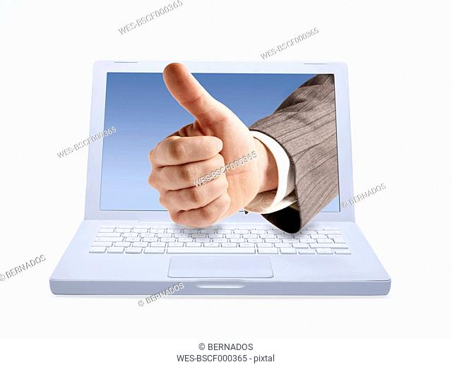 Manager hand giving thumbs up through lap top screen, digital composite