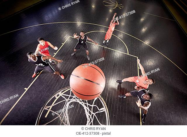 Overhead view young male basketball player shooting free throw in basketball game