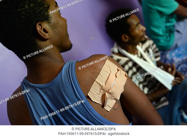 10 June 2019, Sudan, Khartum: Amar Mohammed al-Hassan (l) and Abdu al-Rahim show their injuries. 18-year-old Amar Mohammed al-Hassan and his friends Abdu...