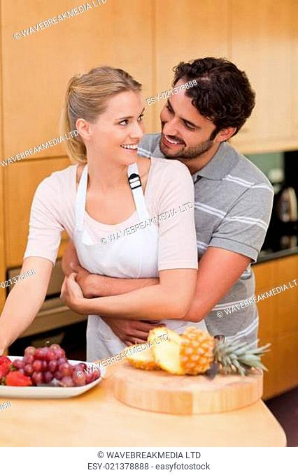 Portrait of a couple eating fruits