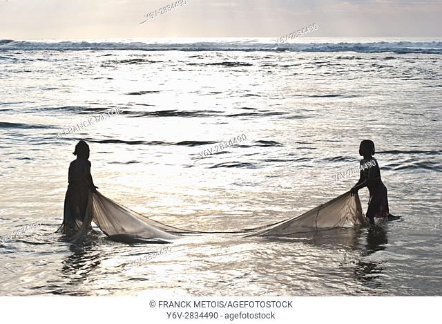 Two girls are fishing ''bichiques'' near Mananjary ( Madagascar). ''Bichiques'' are fry of two species of freshwater fish belonging to the ''gobiidae''family