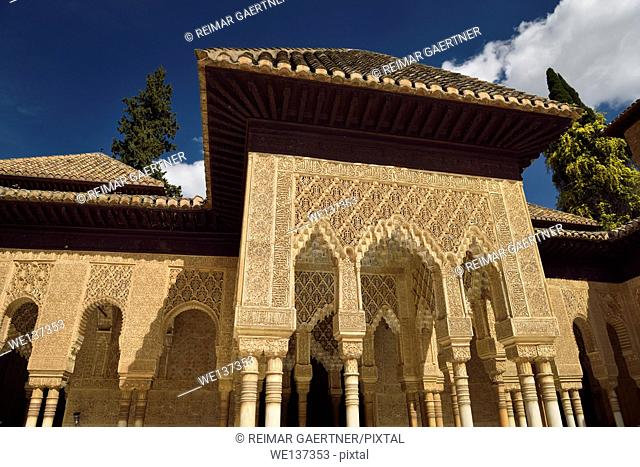 Ornately decorated stiled arches in the courtyard of the Lions at Nasrid Palaces Alhambra Granada