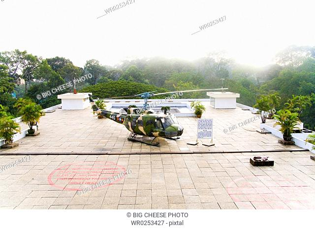 Helicopter on terrace surrounded by jungle