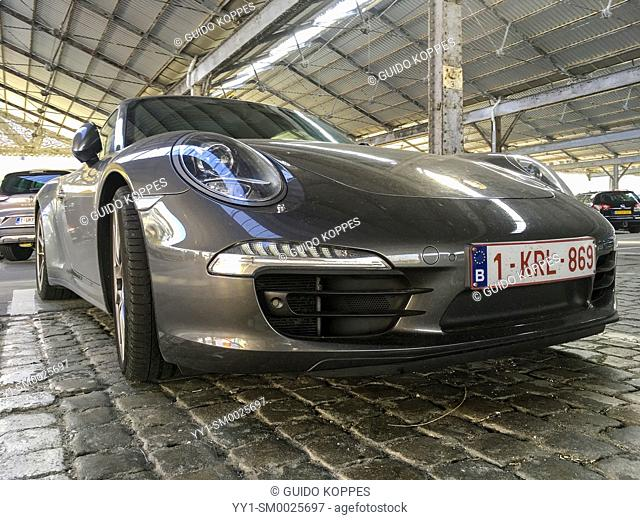 Antwerp, Belgium. real expensive car parked inside a parking garage, being beautifull