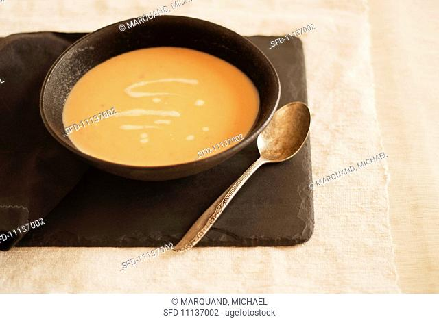 Bowl of Lobster Bisque on Slate with a Spoon