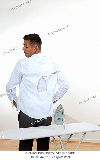 man with hole in shirt