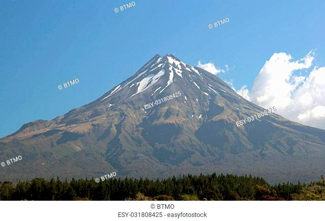 Mt Egmont, aka Mt Taranaki, near New Plymouth in New Zealand. It is unusual to see this mountain - it is normally covered in cloud or rain! It was the...