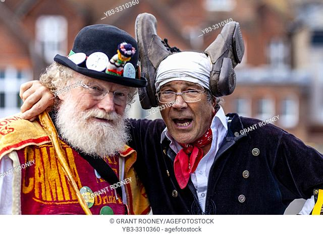 Two Morris Dancers Pose For Photos At The Annual Lewes Folk Festivalâ. . s Day of Dance, Lewes, Sussex, UK