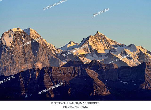 Eiger North Face with Eiger, Monch and Jungfrau mountains in the morning light, Brienzer Rothorn Mountain, Brienz, Switzerland, Europe