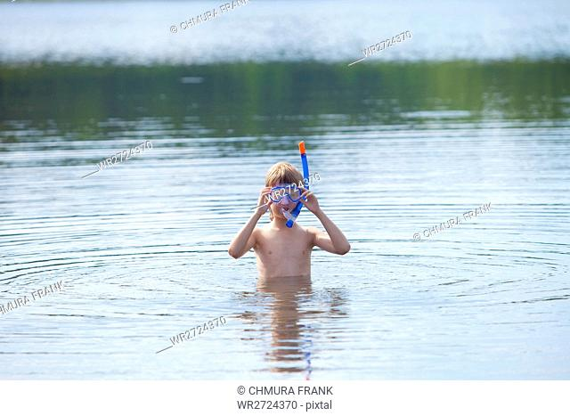 Boy Getting Ready to Snorkel in Lake