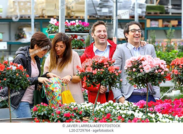 Couples buying flowers, garden center