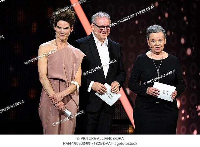 """03 May 2019, Berlin: The actors Ursula Werner (r), Bibiana Beglau and Joachim Krol, give the laudatio in the category """"""""Best Director"""""""" at the 69th German Film..."""