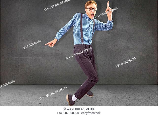 Composite image of geeky hipster dancing to vinyl