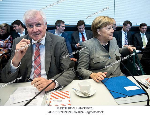 09 October 2018, Berlin: Horst Seehofer, Federal Minister of the Interior, Home and Construction and chairman of the CSU, and Angela Merkel