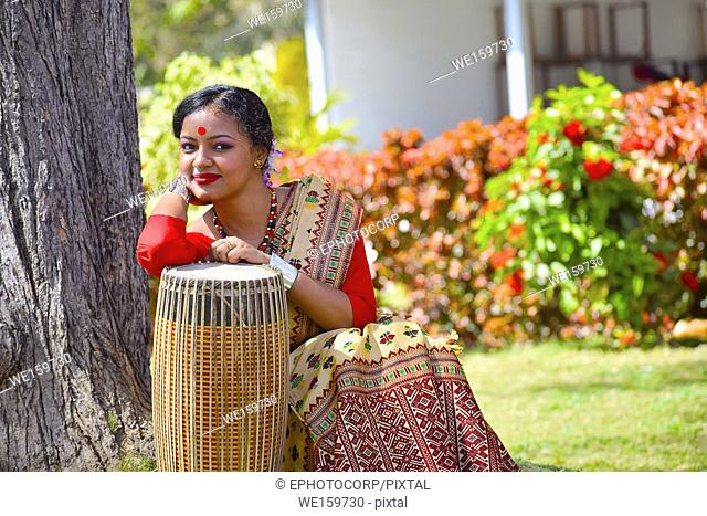 Assamese girl in traditional attire posing with a Dhol(Drum), Pune, Maharashtra